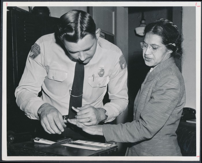 8. Rosa Parks is being fingerprinted by Deputy Sheriff D.H. Lackey after being arrested for boycotting public transportation in Montgomery, Alabama on February 22, 1956.