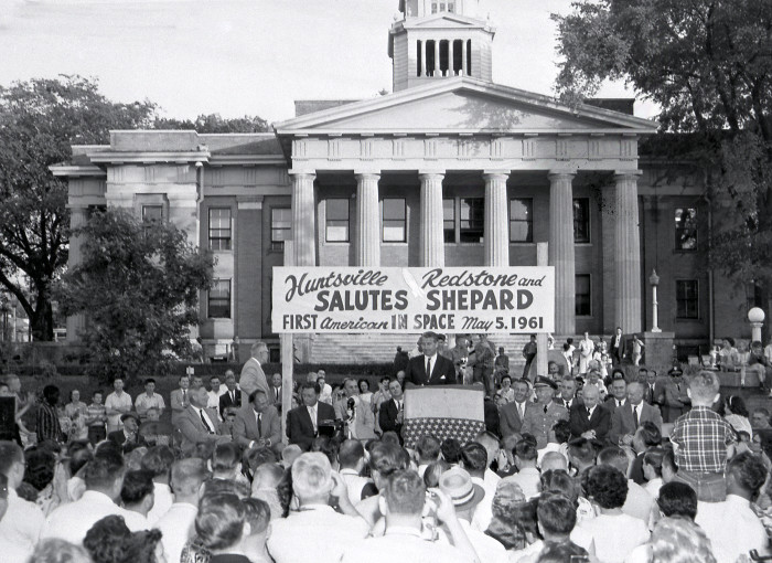 9. Dr. Wernher von Braun is addressing a crowd celebrating in front of the Madison County Courthouse following the successful launch of Astronaut Alan Shepard - America's first astronaut in space. (May 1961)