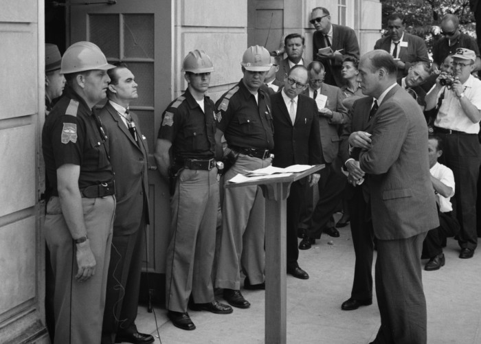 6. George C. Wallace is standing against desegregation while being confronted by Deputy U.S. Attorney General Nicholas Katzenbach at the University of Alabama in 1963.