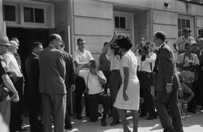 7. Vivian Malone is registering for classes at the University of Alabama in 1963. Ms. Malone was  the university's first African American to graduate.