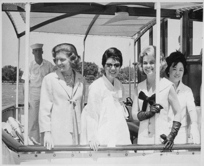 10) Betty Ford with three unidentified women aboard a naval launch at Pearl Harbor.