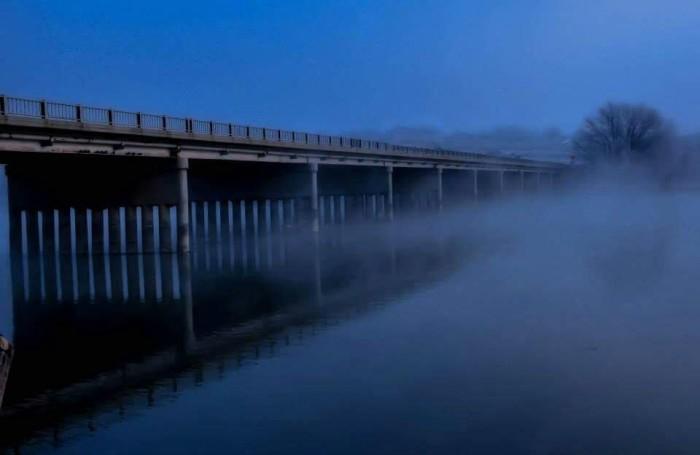 13. A bridge in Marsing paints a misty, austere scene.