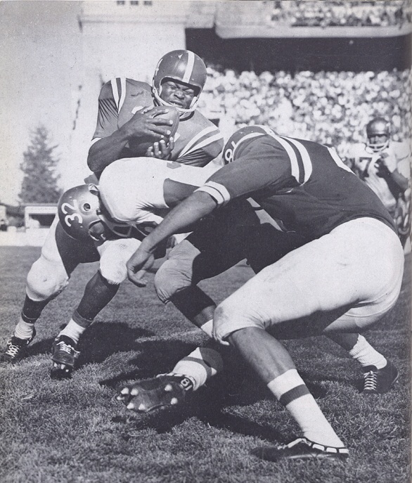 6. The 1959 Huskers lineup included halfback Clay White, seen here mid-tackle.