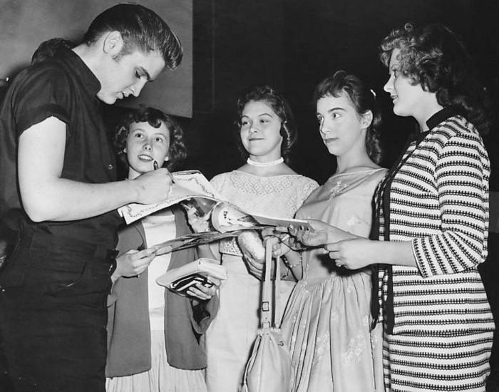 11. Elvis signs autographs in Minneapolis in 1956.