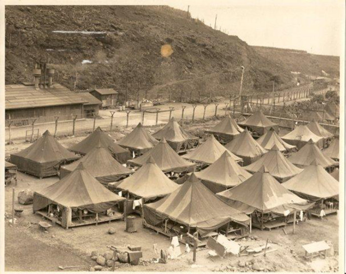 """In the height of the camp's operation, it was bustling – with 175 buildings, 14 guard towers, and more than 400 tents throughout seven compounds on 160 acres. The camp, isolated in a deep gulch, and the Japanese American internees referred to the camp as jigoku dani, or """"hell valley."""""""