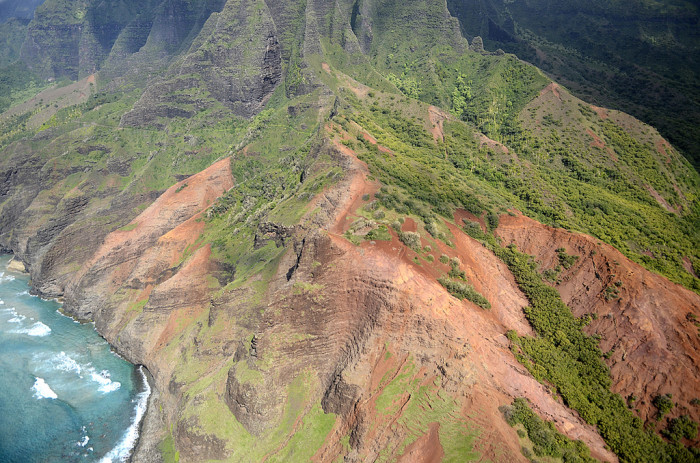 The Kalalau Trail is the only land access to this section of the rugged Na Pali Coastline, and traverses five valleys through lush jungle and towering sea cliffs.