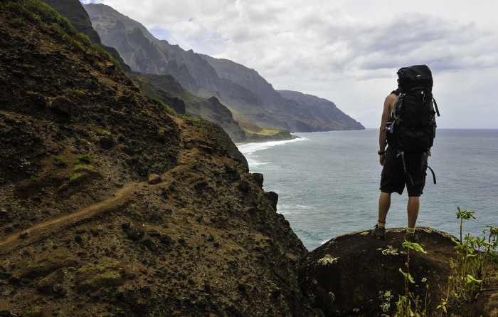 Using trekking poles, wearing hiking boots with awesome treads, and loading heavy items at the bottom of your pack to lower your center of gravity will all help you stay steady on the trail.
