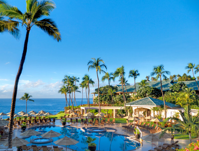 The Four Seasons Resorts Lanai at Manele Bay is set atop a lava cliff overlooking the vast Pacific Ocean, a two-minute walk from Hulopoe Beach and 10 miles from Lanai City.
