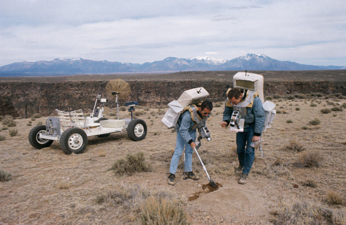 1. Crew members for the Apollo 15 lunar landing mission practice during a simulation near Taos.