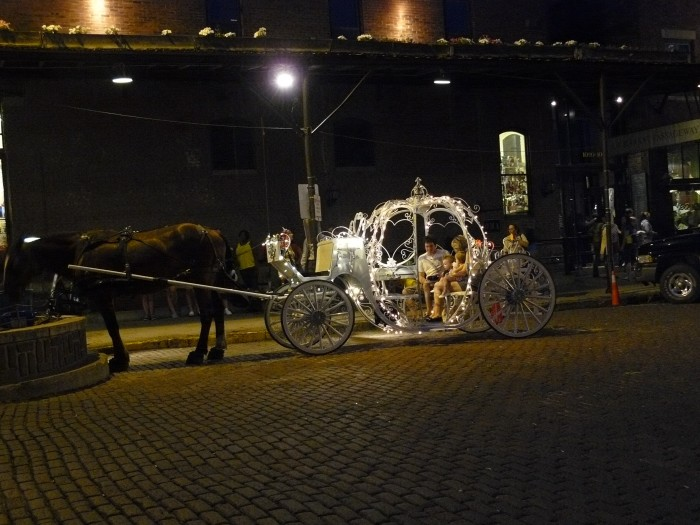 3. Top off dinner with a magical ride in a horse-drawn Cinderella carriage.