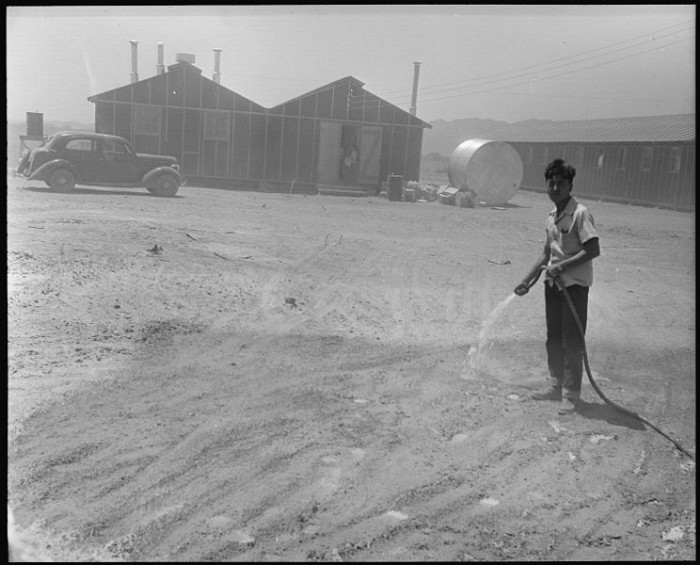 9. This man was going through a futile effort to settle the dust at the Poston internment camp in May 1944.