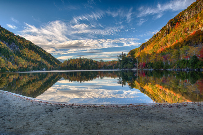 18. The delicate clouds mirrored in Chapel Pond make for an exquisite picture.