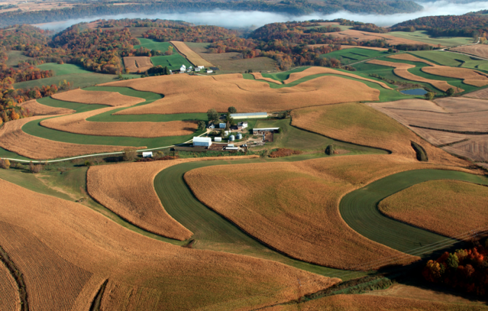 1. Sometimes the best way to experience the beauty of Iowa isn't to drive through it, it's to fly over it. That way we can see all the amazing views like this one - a simple but beautiful farm scene near Millville.