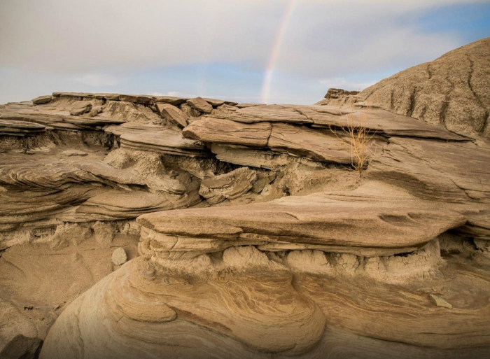 Over the millennia, erosion wore away at the rock formations, revealing the layers of sandstone and clay.