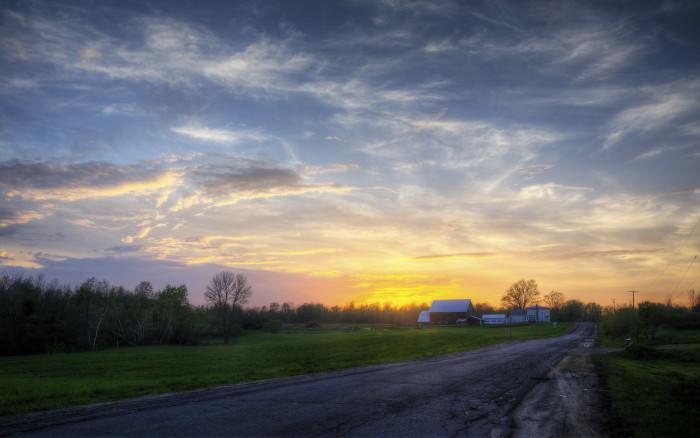 23. The summer sun setting over a Canton farm.