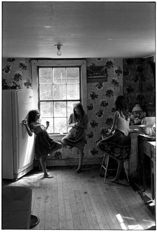 4. Teenage Girls relaxing in the kitchen, circa 1964