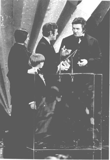 14. Governor Blanton presenting singer Johnny Cash with an Award of Merit in 1977