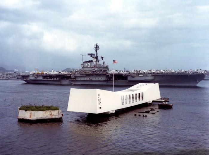 5) The USS Coral Sea photographed behind the USS Arizona Memorial in April 1963.