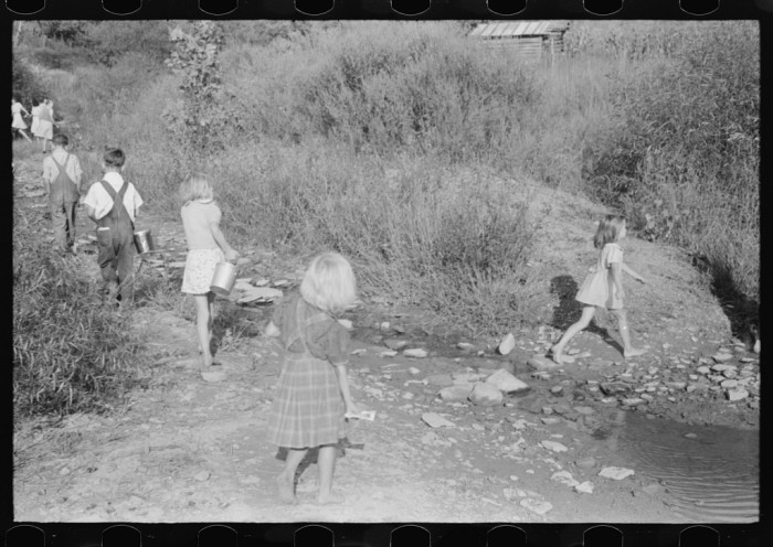 2. Those buckets are the lunch pails kids used in the 1930s, as they walked back and forth to school.