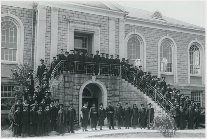 9. A 1950s graduating class of Allen University gathers on the steps of Joseph Simeon Flipper Library.