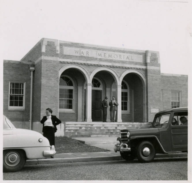 12. A woman waits outside the Allendale Branch of the Allendale-Jasper-Hampton Regional Library in 1951.