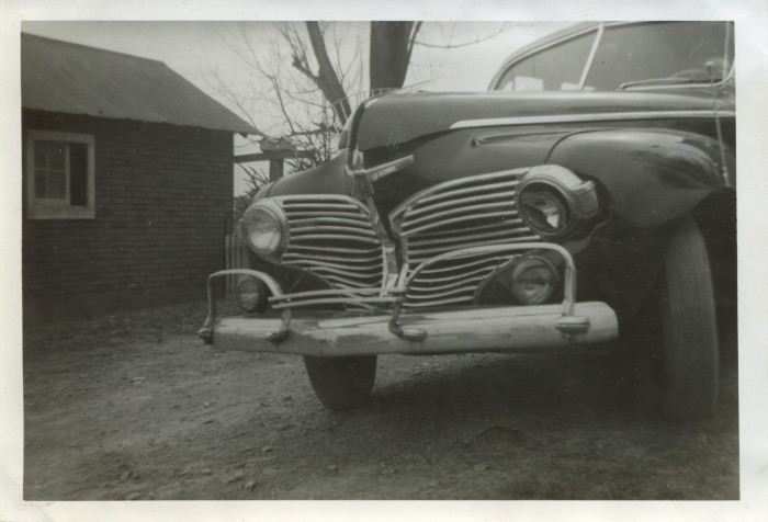 9. This picture of a damaged car was taken near Cameron circa 1952