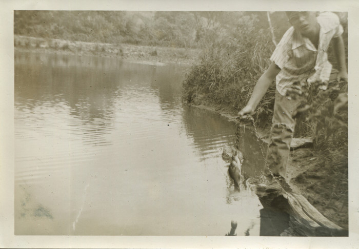 2. Fishing has always been a pastime in West Virginia. This boy is fishing in a pond near Cameron in the 1950s.