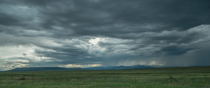 6. Storm clouds roll in over the grasslands.