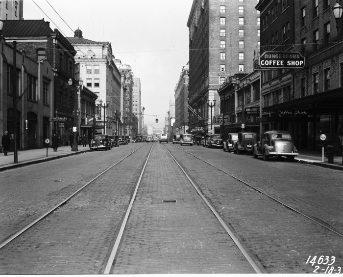 10. Looking down Fourth Avenue in downtown Seattle, 1937.