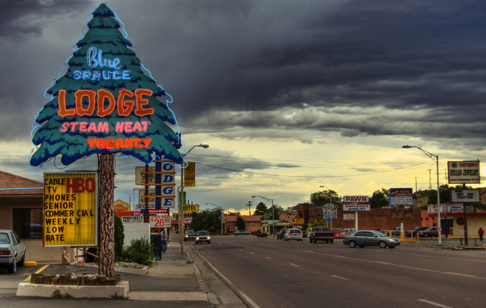 1. Storm clouds create a creepy contrast to the neon lights along this stretch of Route 66 in Gallup.