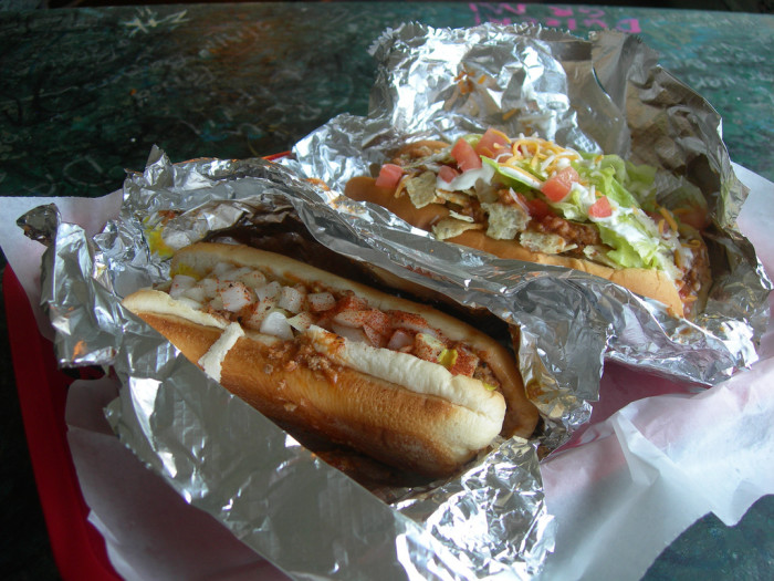 """This is the """"coal miner"""" hotdog, which is a deep-fried dog with homemade chili, mustard, onions and blackening seasoning, and the """"taco dog,"""" with nacho cheese, jalapenos, chili, lettuce, tomatoes, picante, sour cream, cheese and chips."""