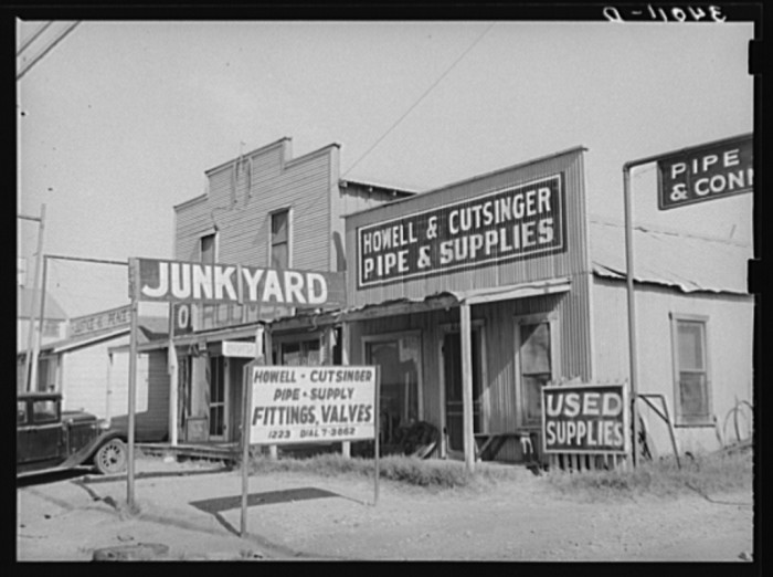 15. A junkyard for oil supplies in Oklahoma City. August 1939.
