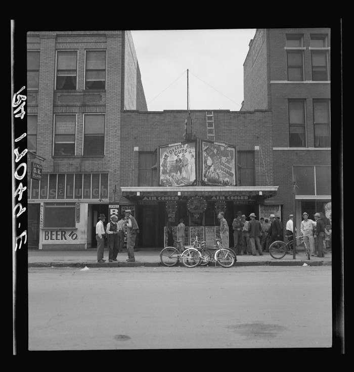 1. These men were waiting to attend a morning movie in Oklahoma City. Taken in 1937.