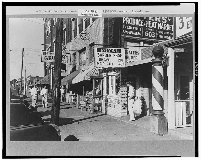 10. The main drag in Okmulgee. Haircuts were $0.40 and shaves were $0.20. 1939.