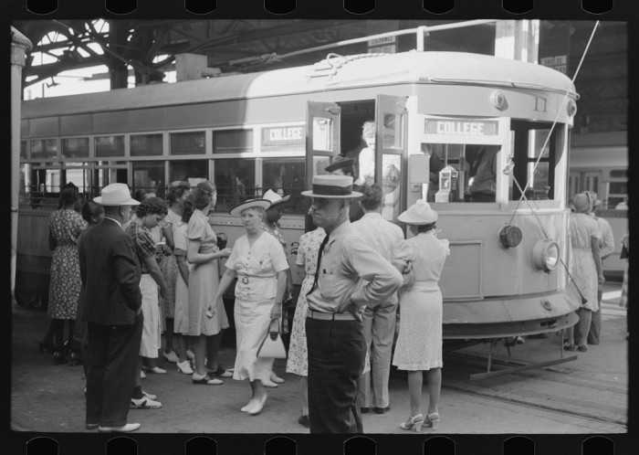 13. People getting on and off the streetcar in Oklahoma City. 1939.