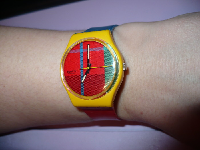 5. Sporting your new Swatch Watch.