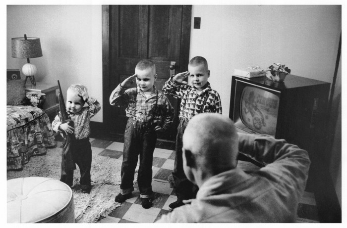 17. In this photo from Parris Island, South Carolina, a  drill instructor's young sons are saluting their father at home.