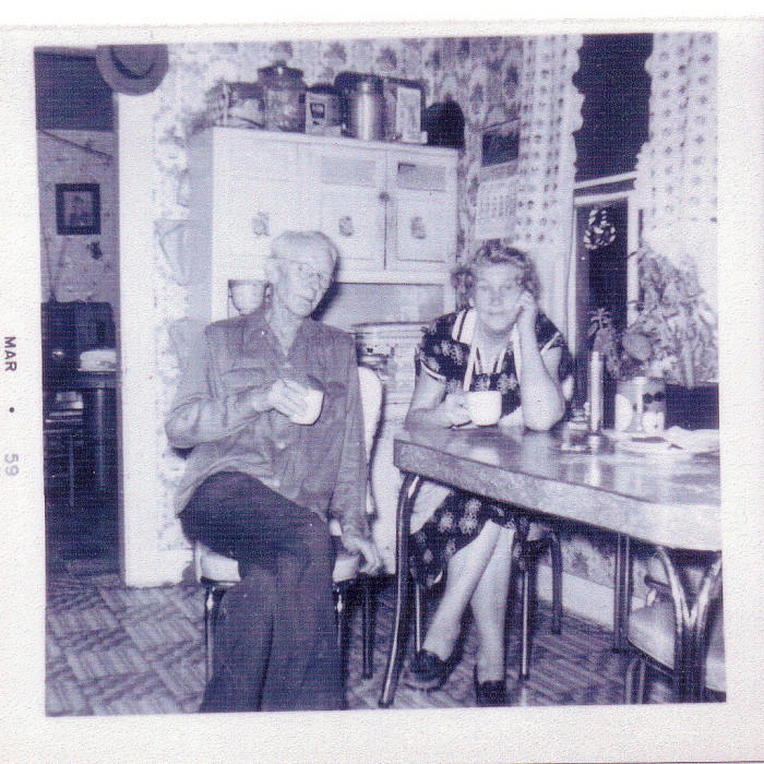 12. Jerry Hood and Mary Jane Covey enjoy a cup of coffee in this kitchen in Rachel, W.Va. (Marion County) circa 1950.