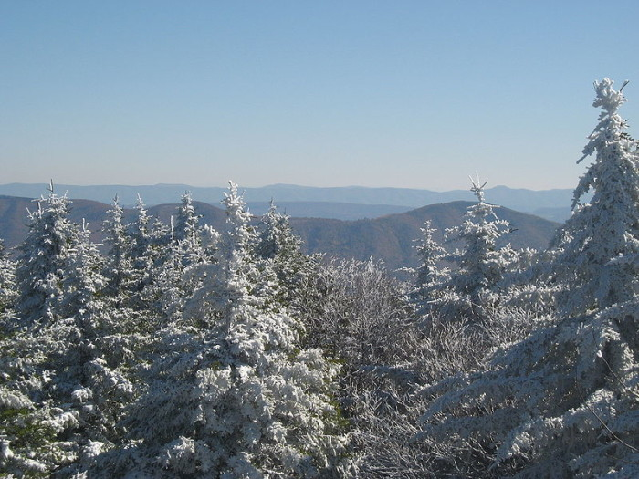 Winters on Spruce Mountain are cold and snowy. It gets an average of more than 180 inches  of snow each year. The summit access road is often impassible between October and April.