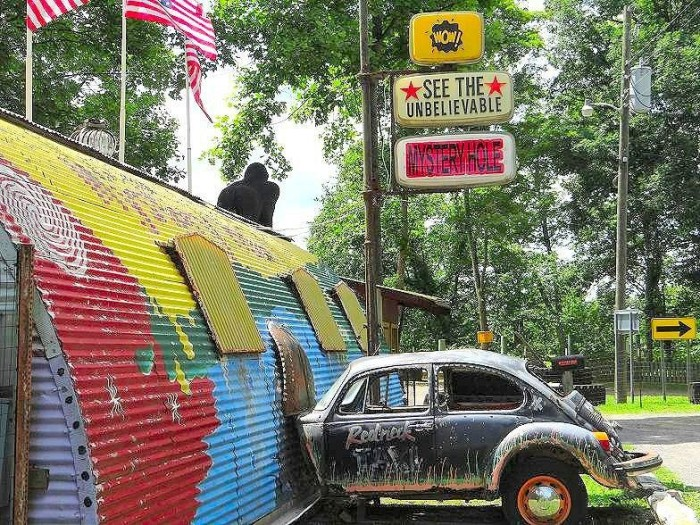The mystery involves a brightly colored Quonset hut with a gorilla statue and a Volkswagen seemingly crashed into the side. It sits along the roadway on Route 60.