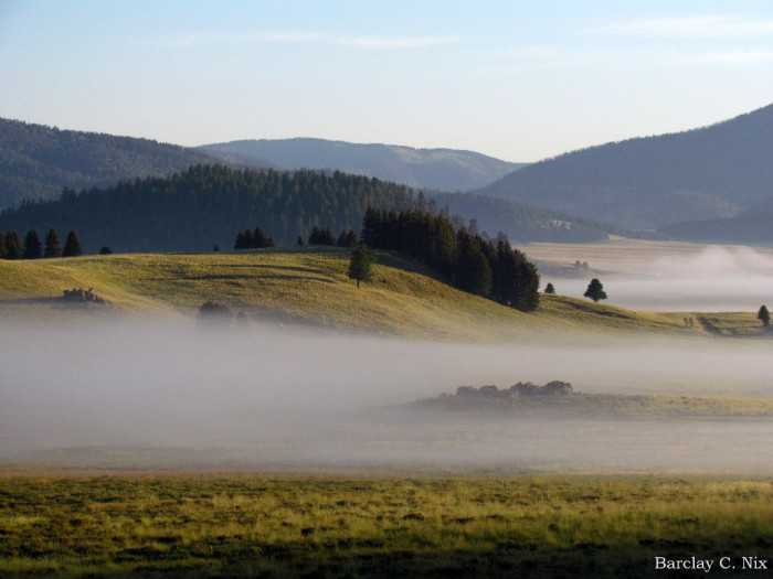 4. Fog, thick enough that it looks tangible, drapes across Valles Caldera, in the Jemez Mountains.