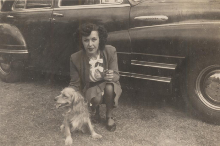 woman-poses-with-family-dog-in-beaufort-