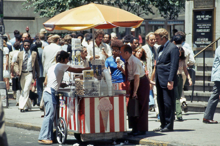 20. Tall hair, mustaches and wide-leg pants, taken in 1975 you can see New York's busy bees enjoying their lunch break on Wall Street.