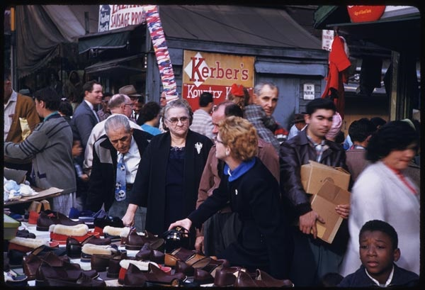 6. Shoppers navigate a Chicago market back in 1958.