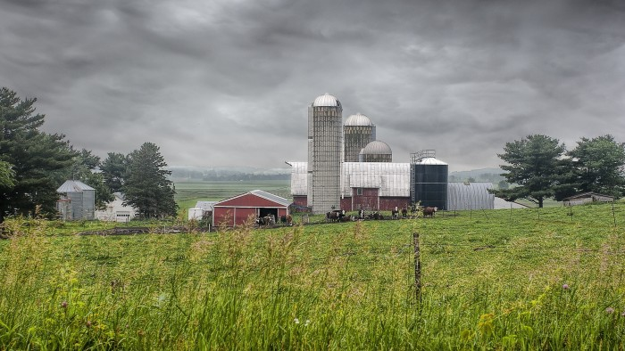 1. Storm clouds make this farm scene extra dramatic.
