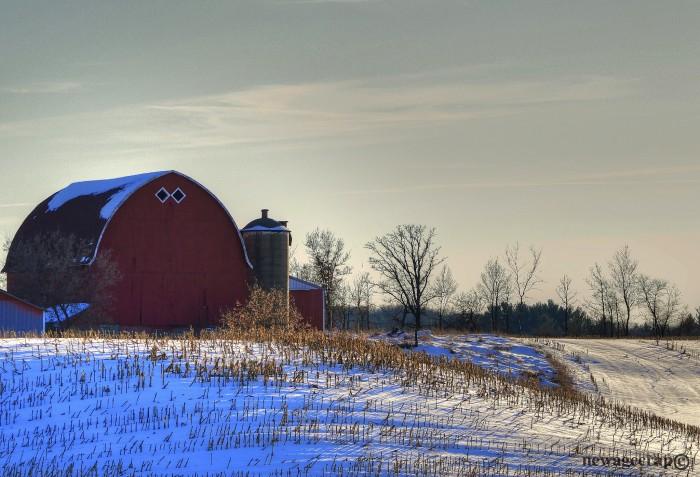 7. The red barn pops in the white snow in Arnott.