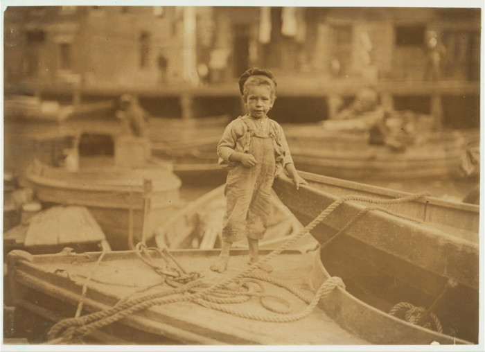 6. A young truant hanging around boats in the harbor during school hours. Boston. (1909)
