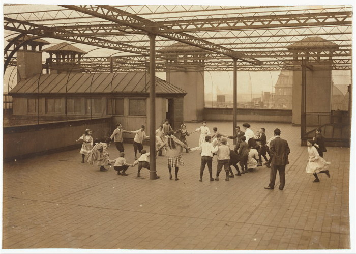 8. Immigrant children learning to play on the roof garden of the Washington School in Boston. (1915)