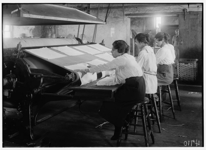 10. Girls working at mangle in Bonanno Laundry at 12 Foster Wharf, Boston. All are 15 years old and go to continuation school. (1917)