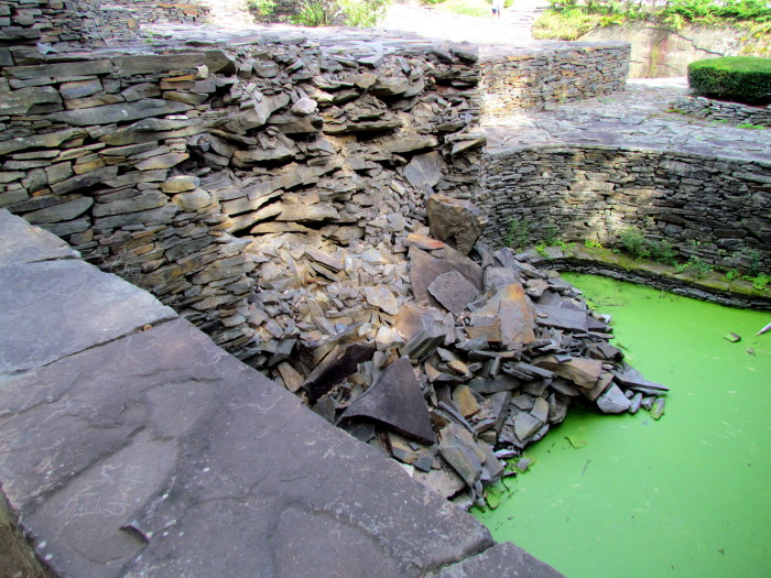 After the harsh weather brought on by Hurricanes Irene & Sandy, one of the walls of Opus 40 experienced significant damage.